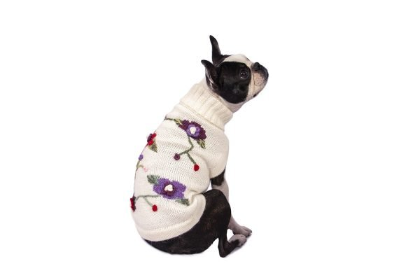 """<span style=""""font-weight: 400;"""">This playful intarsia sweater is beautifully detailed with hand-embroidered flowers and leaves in soft hues of violet, burgundy, rose, and greens. The Flower alpaca dog sweater promises to take every dog's breath away.</span> <ul> <li aria-level=""""1"""">Handcrafted from alpaca fiber blends</li> <li style=""""font-weight: 400;"""" aria-level=""""1""""><span style=""""font-weight: 400;"""">Soft</span><span style=""""font-weight: 400;""""> and warm to the touch</span></li> <li style=""""font-weight: 400;"""" aria-level=""""1""""><span style=""""font-weight: 400;"""">Not itchy & hypoallergenic</span></li> <li><span style=""""font-weight: 400;"""">Leash opening</span></li> </ul> - Model Charlotte is a Shih tzu size XS - Model Cala is a Small Female Boston Terrier size XS This garment has been designed thinking on the well being of your pet. [fusion_button link=""""https://alqowasi.com/wp-content/uploads/2021/03/Sizing-guide-sweater-dresses.png"""" text_transform=""""none"""" title="""""""" target=""""lightbox"""" link_attributes="""""""" alignment_medium="""""""" alignment_small="""""""" alignment="""""""" modal="""""""" hide_on_mobile=""""small-visibility,medium-visibility,large-visibility"""" sticky_display=""""normal,sticky"""" class=""""button-chart"""" id="""""""" color=""""default"""" button_gradient_top_color="""""""" button_gradient_bottom_color="""""""" button_gradient_top_color_hover="""""""" button_gradient_bottom_color_hover="""""""" accent_color="""""""" accent_hover_color="""""""" type="""""""" bevel_color="""""""" border_width="""""""" border_radius="""""""" border_color="""""""" border_hover_color="""""""" size=""""small"""" stretch=""""default"""" margin_top="""""""" margin_right="""""""" margin_bottom="""""""" margin_left="""""""" icon=""""fa-ruler fas"""" icon_position=""""left"""" icon_divider=""""no"""" animation_type="""""""" animation_direction=""""left"""" animation_speed=""""0.3"""" animation_offset=""""""""]Sizing Chart[/fusion_button]"""