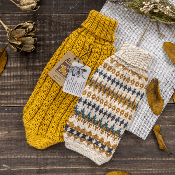 """<span style=""""font-weight: 400;"""">Sophisticated yet playful with its multicolored pattern, this pullover is made from alpaca fiber blends and was designed with comfort in mind. Our Golden Dreams alpaca dog sweater is a wardrobe win.</span> <ul> <li aria-level=""""1"""">Handcrafted from alpaca fiber blends</li> <li style=""""font-weight: 400;"""" aria-level=""""1""""><span style=""""font-weight: 400;"""">Soft</span><span style=""""font-weight: 400;""""> and warm to the touch</span></li> <li style=""""font-weight: 400;"""" aria-level=""""1""""><span style=""""font-weight: 400;"""">Not itchy & hypoallergenic</span></li> <li><span style=""""font-weight: 400;"""">Leash opening</span></li> </ul> – Model Gloria is a Miniature Dachshund Size XS This garment has been designed thinking on the well-being of your pet. <strong>Note:</strong>There is a slight variation in 2020 vs. 2021 beige tone. 2020 beige was a little more buttery/ivory tone than this year 2021 is more natural beige. [fusion_button link=""""https://alqowasi.com/wp-content/uploads/2021/03/Sizing-guide-sweater-dresses.png"""" text_transform=""""none"""" title="""""""" target=""""lightbox"""" link_attributes="""""""" alignment_medium="""""""" alignment_small="""""""" alignment="""""""" modal="""""""" hide_on_mobile=""""small-visibility,medium-visibility,large-visibility"""" sticky_display=""""normal,sticky"""" class=""""button-chart"""" id="""""""" color=""""default"""" button_gradient_top_color="""""""" button_gradient_bottom_color="""""""" button_gradient_top_color_hover="""""""" button_gradient_bottom_color_hover="""""""" accent_color="""""""" accent_hover_color="""""""" type="""""""" bevel_color="""""""" border_width="""""""" border_radius="""""""" border_color="""""""" border_hover_color="""""""" size=""""small"""" stretch=""""default"""" margin_top="""""""" margin_right="""""""" margin_bottom="""""""" margin_left="""""""" icon=""""fa-ruler fas"""" icon_position=""""left"""" icon_divider=""""no"""" animation_type="""""""" animation_direction=""""left"""" animation_speed=""""0.3"""" animation_offset=""""""""]Sizing Chart[/fusion_button]"""