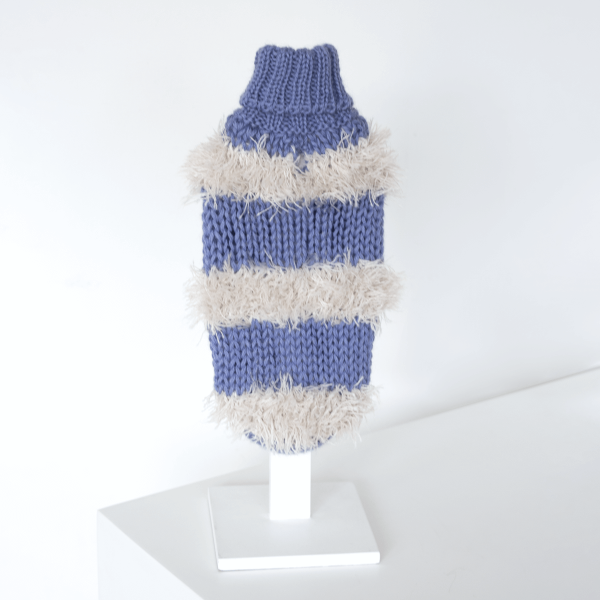 """<span style=""""font-weight: 400;"""">The Game of Bones Light blue alpaca dog sweater is a flirty fabulous sweater with layered fringing for this cold weather. It gives your pooch a unique sense of style.</span> <ul> <li aria-level=""""1"""">Handcrafted from alpaca fiber blends</li> <li style=""""font-weight: 400;"""" aria-level=""""1""""><span style=""""font-weight: 400;"""">Soft</span><span style=""""font-weight: 400;""""> and warm to the touch</span></li> <li style=""""font-weight: 400;"""" aria-level=""""1""""><span style=""""font-weight: 400;"""">Not itchy & hypoallergenic</span></li> <li><span style=""""font-weight: 400;"""">Leash opening</span></li> </ul> This garment has been designed thinking on the well-being of your pet. [fusion_button link=""""https://alqowasi.com/wp-content/uploads/2021/03/Sizing-guide-sweater-dresses.png"""" text_transform=""""none"""" title="""""""" target=""""lightbox"""" link_attributes="""""""" alignment_medium="""""""" alignment_small="""""""" alignment="""""""" modal="""""""" hide_on_mobile=""""small-visibility,medium-visibility,large-visibility"""" sticky_display=""""normal,sticky"""" class=""""button-chart"""" id="""""""" color=""""default"""" button_gradient_top_color="""""""" button_gradient_bottom_color="""""""" button_gradient_top_color_hover="""""""" button_gradient_bottom_color_hover="""""""" accent_color="""""""" accent_hover_color="""""""" type="""""""" bevel_color="""""""" border_width="""""""" border_radius="""""""" border_color="""""""" border_hover_color="""""""" size=""""small"""" stretch=""""default"""" margin_top="""""""" margin_right="""""""" margin_bottom="""""""" margin_left="""""""" icon=""""fa-ruler fas"""" icon_position=""""left"""" icon_divider=""""no"""" animation_type="""""""" animation_direction=""""left"""" animation_speed=""""0.3"""" animation_offset=""""""""]Sizing Chart[/fusion_button]"""