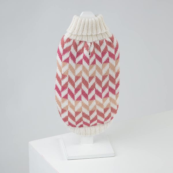 """Heritage and contemporary designs fuse seamlessly in the Herringbone alpaca dog sweater, which gives instantly recognizable classics a fresh new look. Now available in pretty pink. <ul> <li aria-level=""""1"""">Handcrafted from alpaca fiber blends</li> <li style=""""font-weight: 400;"""" aria-level=""""1""""><span style=""""font-weight: 400;"""">Soft</span><span style=""""font-weight: 400;""""> and warm to the touch</span></li> <li style=""""font-weight: 400;"""" aria-level=""""1""""><span style=""""font-weight: 400;"""">Not itchy & hypoallergenic</span></li> <li><span style=""""font-weight: 400;"""">Leash opening</span></li> </ul> – Pepper is a Boston Terrier size XSmall – Zelda is a Boston Terrier 6 month size XXSmall This garment has been designed thinking on the well-being of your pet. [fusion_button link=""""https://alqowasi.com/wp-content/uploads/2021/03/Sizing-guide-sweater-dresses.png"""" text_transform=""""none"""" title="""""""" target=""""lightbox"""" link_attributes="""""""" alignment_medium="""""""" alignment_small="""""""" alignment="""""""" modal="""""""" hide_on_mobile=""""small-visibility,medium-visibility,large-visibility"""" sticky_display=""""normal,sticky"""" class=""""button-chart"""" id="""""""" color=""""default"""" button_gradient_top_color="""""""" button_gradient_bottom_color="""""""" button_gradient_top_color_hover="""""""" button_gradient_bottom_color_hover="""""""" accent_color="""""""" accent_hover_color="""""""" type="""""""" bevel_color="""""""" border_width="""""""" border_radius="""""""" border_color="""""""" border_hover_color="""""""" size=""""small"""" stretch=""""default"""" margin_top="""""""" margin_right="""""""" margin_bottom="""""""" margin_left="""""""" icon=""""fa-ruler fas"""" icon_position=""""left"""" icon_divider=""""no"""" animation_type="""""""" animation_direction=""""left"""" animation_speed=""""0.3"""" animation_offset=""""""""]Sizing Chart[/fusion_button]  <strong>Please note that orders that placed during this week including PRE-ORDERED garments will be shipped from September 27th to October 4th, 2021. As always, we can assure you that our unique collection is worth the wait. Once your order is ready to ship, delivery time ranges from 3-5 business days worldwide with DHL.</strong>"""