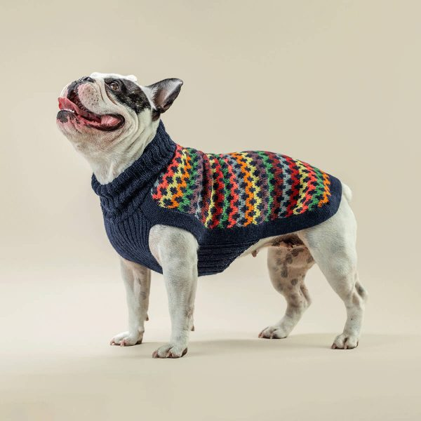 """Our Crossroads alpaca dog sweater is the perfect addition to your furry friend's cold-weather wardrobe. Sophisticated yet playful with its multicolored pattern, this pullover is made from alpaca fiber and was designed with comfort in mind. Now available in Blue! <ul> <li aria-level=""""1"""">Handcrafted from alpaca fiber blends</li> <li style=""""font-weight: 400;"""" aria-level=""""1""""><span style=""""font-weight: 400;"""">Soft</span><span style=""""font-weight: 400;""""> and warm to the touch</span></li> <li style=""""font-weight: 400;"""" aria-level=""""1""""><span style=""""font-weight: 400;"""">Not itchy & hypoallergenic</span></li> <li><span style=""""font-weight: 400;"""">Leash opening</span></li> </ul> – Model Ramona is a French Bulldog Size M This garment has been designed thinking on the well-being of your pet. [fusion_button link=""""https://alqowasi.com/wp-content/uploads/2021/03/Sizing-guide-sweater-dresses.png"""" text_transform=""""none"""" title="""""""" target=""""lightbox"""" link_attributes="""""""" alignment_medium="""""""" alignment_small="""""""" alignment="""""""" modal="""""""" hide_on_mobile=""""small-visibility,medium-visibility,large-visibility"""" sticky_display=""""normal,sticky"""" class=""""button-chart"""" id="""""""" color=""""default"""" button_gradient_top_color="""""""" button_gradient_bottom_color="""""""" button_gradient_top_color_hover="""""""" button_gradient_bottom_color_hover="""""""" accent_color="""""""" accent_hover_color="""""""" type="""""""" bevel_color="""""""" border_width="""""""" border_radius="""""""" border_color="""""""" border_hover_color="""""""" size=""""small"""" stretch=""""default"""" margin_top="""""""" margin_right="""""""" margin_bottom="""""""" margin_left="""""""" icon=""""fa-ruler fas"""" icon_position=""""left"""" icon_divider=""""no"""" animation_type="""""""" animation_direction=""""left"""" animation_speed=""""0.3"""" animation_offset=""""""""]Sizing Chart[/fusion_button]  <strong>Please note that orders that placed during this week including PRE-ORDERED garments will be shipped from September 27th to October 4th, 2021. As always, we can assure you that our unique collection is worth the wait. Once your order is ready to ship, delivery time ranges from 3-5 business days worldw"""